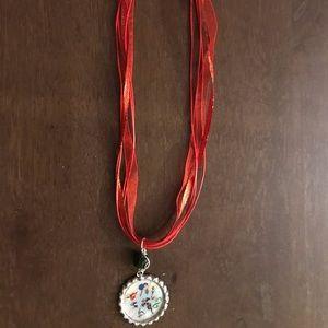 Awesome superhero girl bottlecap necklace.